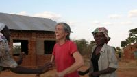 Lisa Merton dancing with GBM members near Machakos, Kenya