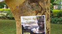 A Taking Root poster on a tree in Kenya advertising a campus screening. August 2010