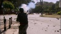 Police firing tear gas at students protesting the destruction of Karura Forest, 1999